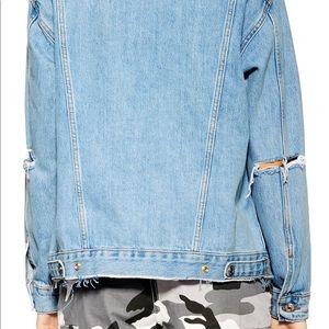Oversized/ distressed denim jacket